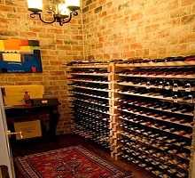 mediterranean-wine-cellar-rustic-wood-flooring-cellar-designs-brick-wall-wine-antique-rugs-area-atticmag